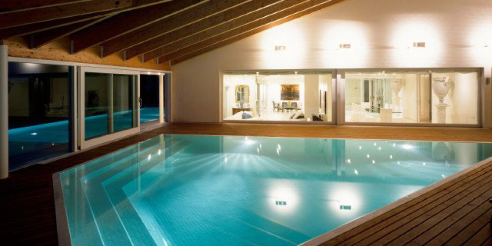 Indoor swimming pool with wood panelling