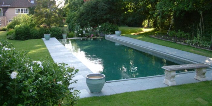Outdoor swimming pool installation with bench