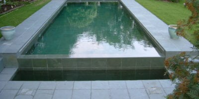 Outdoor swimming pool with automatic cover