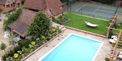 Outdoor swimming pool in country back garden