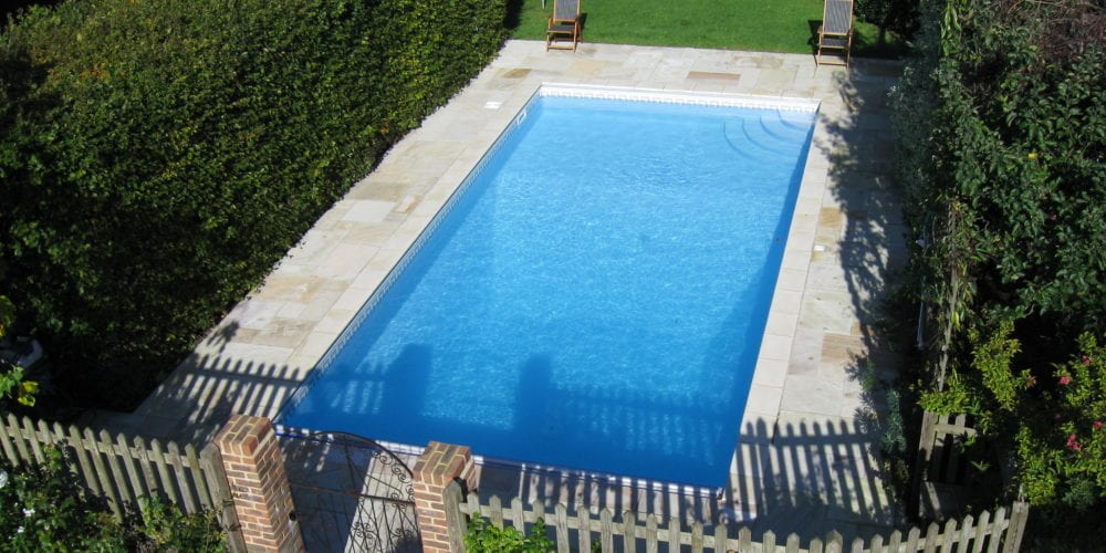 Aerial shot of new swimming pool installation in Surrey