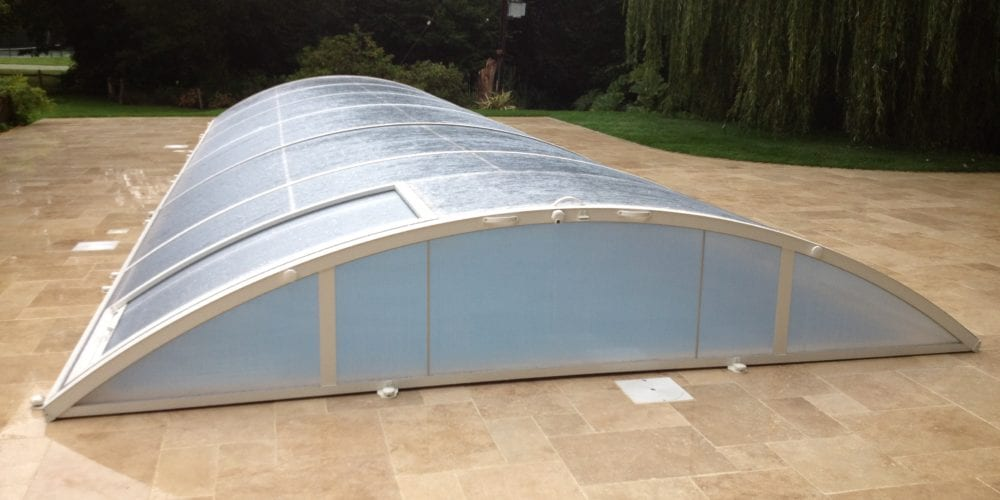 Outdoor pool enclosure on new pool paving