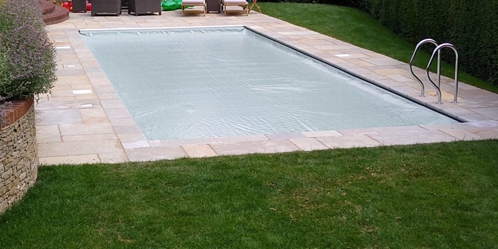 Covered outdoor swimming pool with grabrail