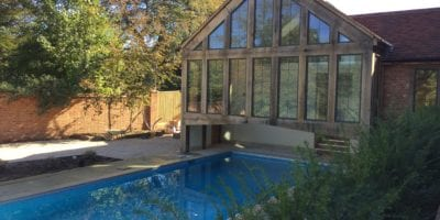 Outdoor swimming pool with covered end