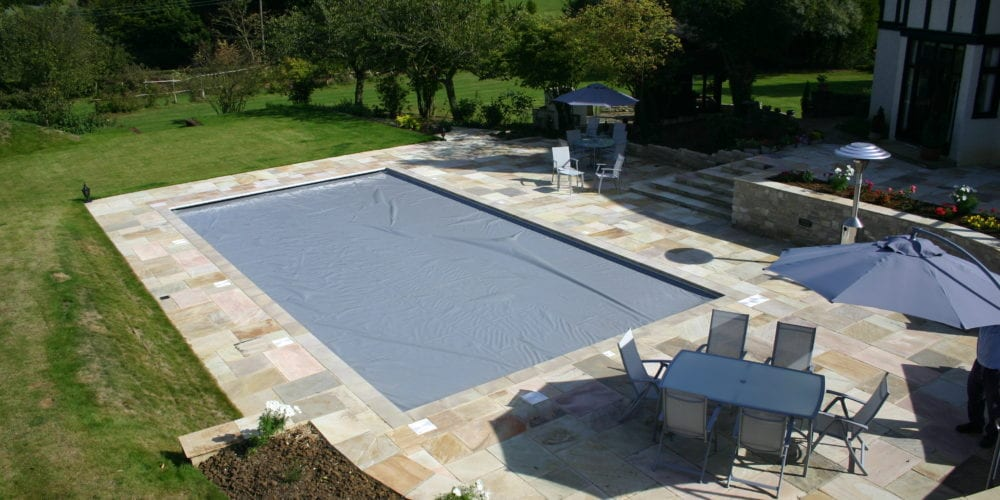 Outdoor swimming pool installation in Surrey with aquamatic cover
